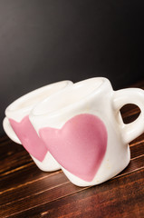 two coffee cup on wooden background