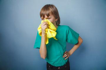 Boy, teenager, twelve years in a green t-shirt , handkerchief