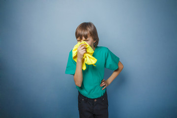Boy, teenager, twelve years in a green t-shirt, handkerchief