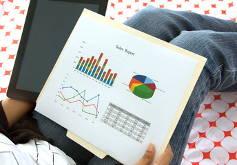 Business executive analyzing corporate data and reports