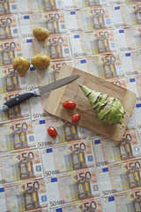 cooking and cutting vegetables on money floor