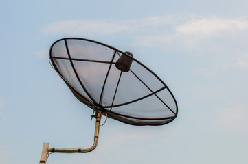 Satellite dish with sky background.