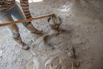 Worker is  mixing mortar