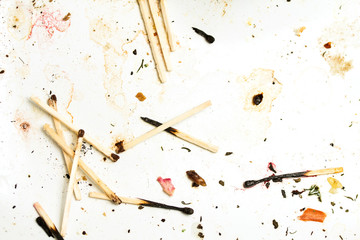 Group of burned matches on the dirt background