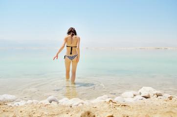 Girl bathe in Dead Sea