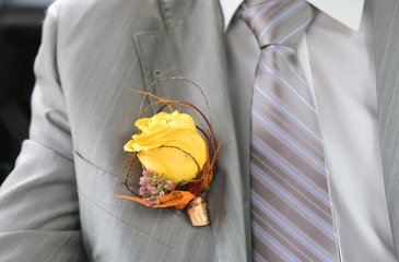 Yelllow boutonniere groom