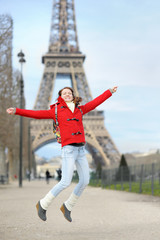 Young woman having fun near the Eiffel tower