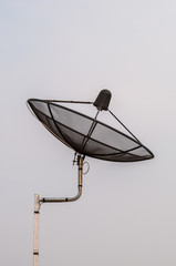 Satellite dish with blue sky background.