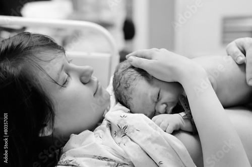 Woman with newborn baby right after delivery