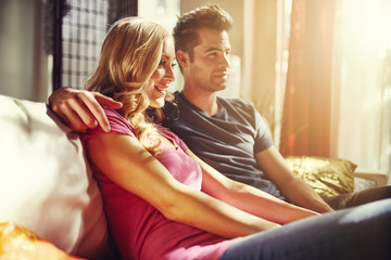 couple watching something at home with lens flare