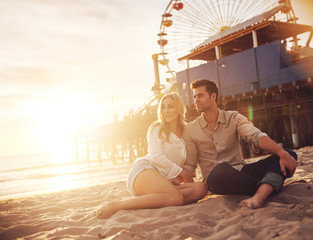 romantic couple enjoying sunset at santa monica