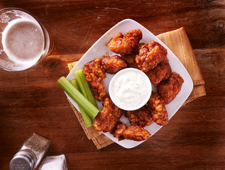 bbq buffalo chicken wings with beer ranch and celery