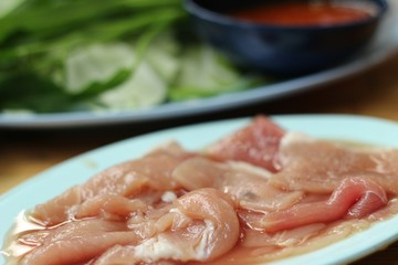 Raw pork in the dish for sukiyaki.