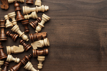 chess figures on brown wooden table background