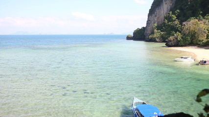 motor speed boat tied up at picturesque rocky island coast in tr