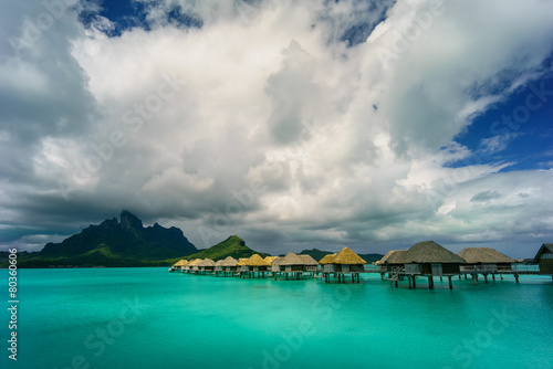 Leinwanddruck Bild Bora Bora under dramatic clouds