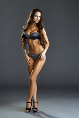 Image of smiling model advertises erotic lingerie