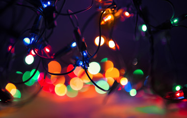Christmas lights on dark background. Decorative garland. Tinted