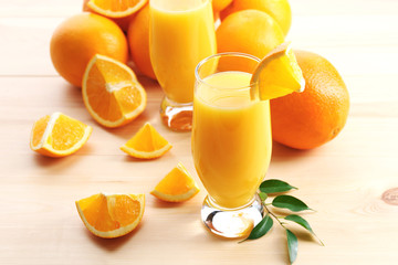 Freshly squeezed orange juice on wooden table