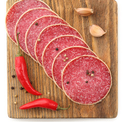Slices of salami with chili pepper and spices