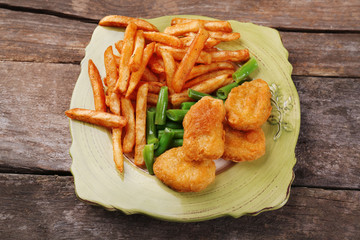 Breaded fried chicken nuggets and potatoes with asparagus