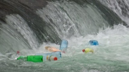 Plastic bottles floating and polluting at river