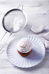 Delicious coconut cupcake with cream