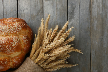 Bread with ears on wooden background