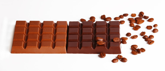 Milk and black chocolate bars with coffee beans isolated