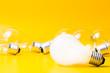 Light bulbs on yellow background