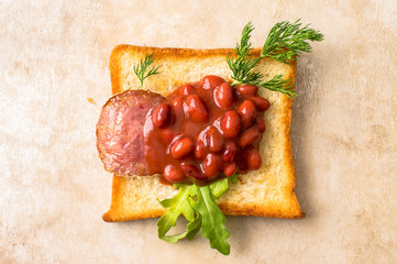 Tapas with sausage and beans