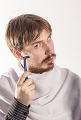Young man holding a razor. concept