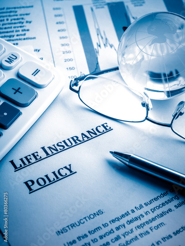 Leinwanddruck Bild life insurance policy on the desk.