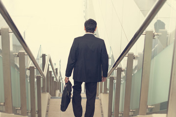 indian business male walking on stairs