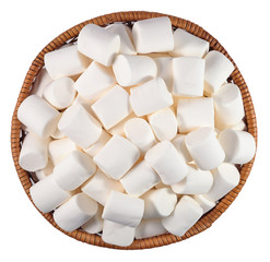 White marshmallow in a wicker bowl on a white