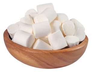 White marshmallow in a wooden bowl on a white