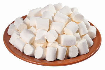 White marshmallow on a ceramic plate on a white