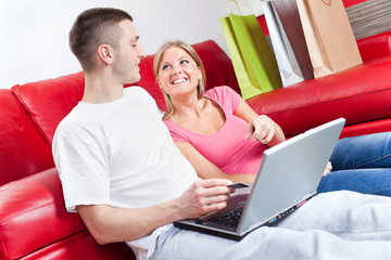 Happy couple shopping on internet