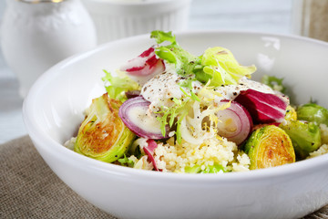 Healthy salad with couscous in a bowl