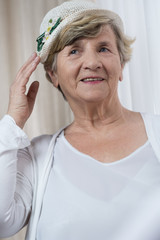 Happy retired woman in boater