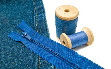 blue denim with zipper and spools of thread