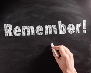 Handwritten Remember Text on Black Chalkboard