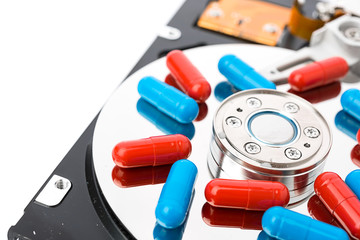 Pills on computer hard drive - concept technology background
