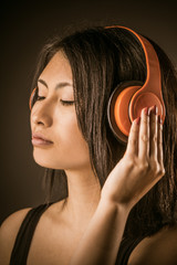 Pretty Asian woman listening to music