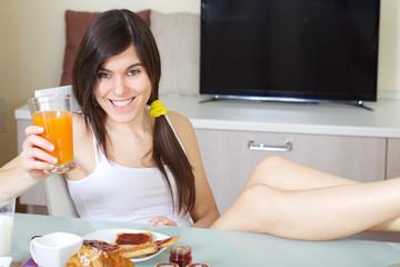 young brunette having a breakfast