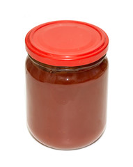 glass jar with tomato juice on a white background