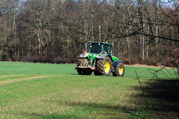 tractor on a green field in early spring