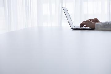 Woman's hand, notebook computer, keyboard