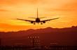 Leinwanddruck Bild - Landing Airplane at Sunset