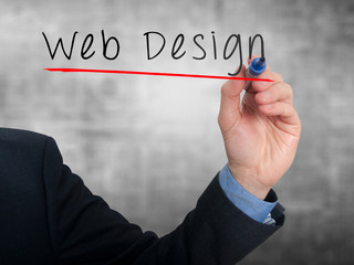 Businessman writing Web Design concept. Stock Photo